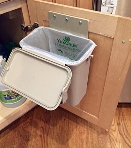Cabinet mounted 1.5 gallon compost bin. Keeps compost scraps out of the way in this easy to use compost container. Use plastic grocery bags and recycle those as well. Kitchen countertop compost bin. #HowToMakeOrganicCompost #MakingOrganicCompost #KitchenCompost #GardensAll #MakeCompost #OrganicCompost #GardensAll